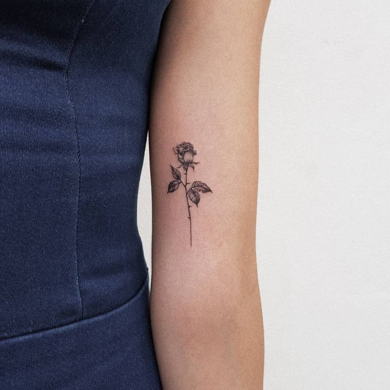 minimalist rose tattoo