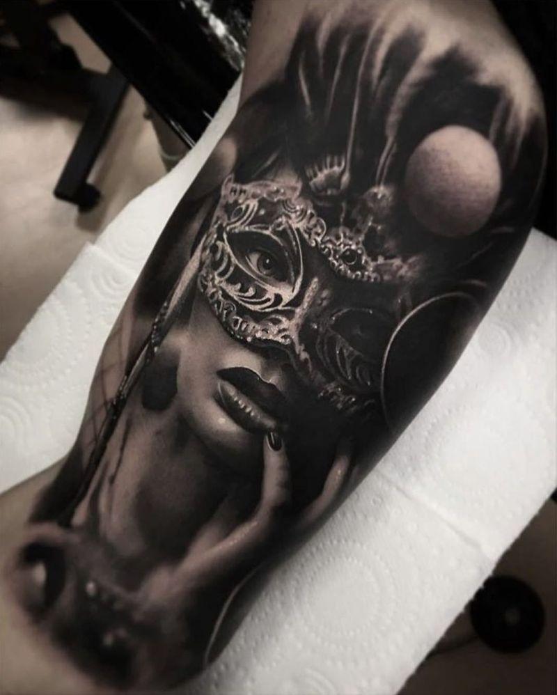 black & gray Venetian mask tattoo