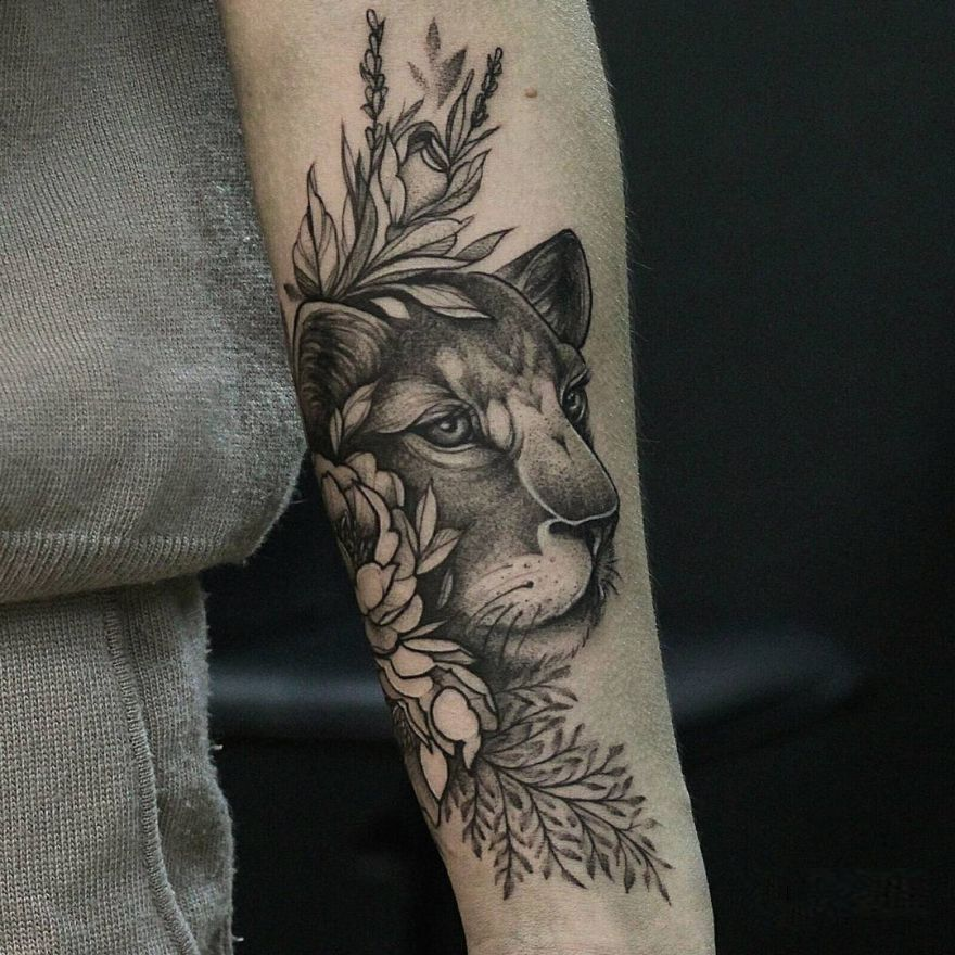 floral lioness tattoo