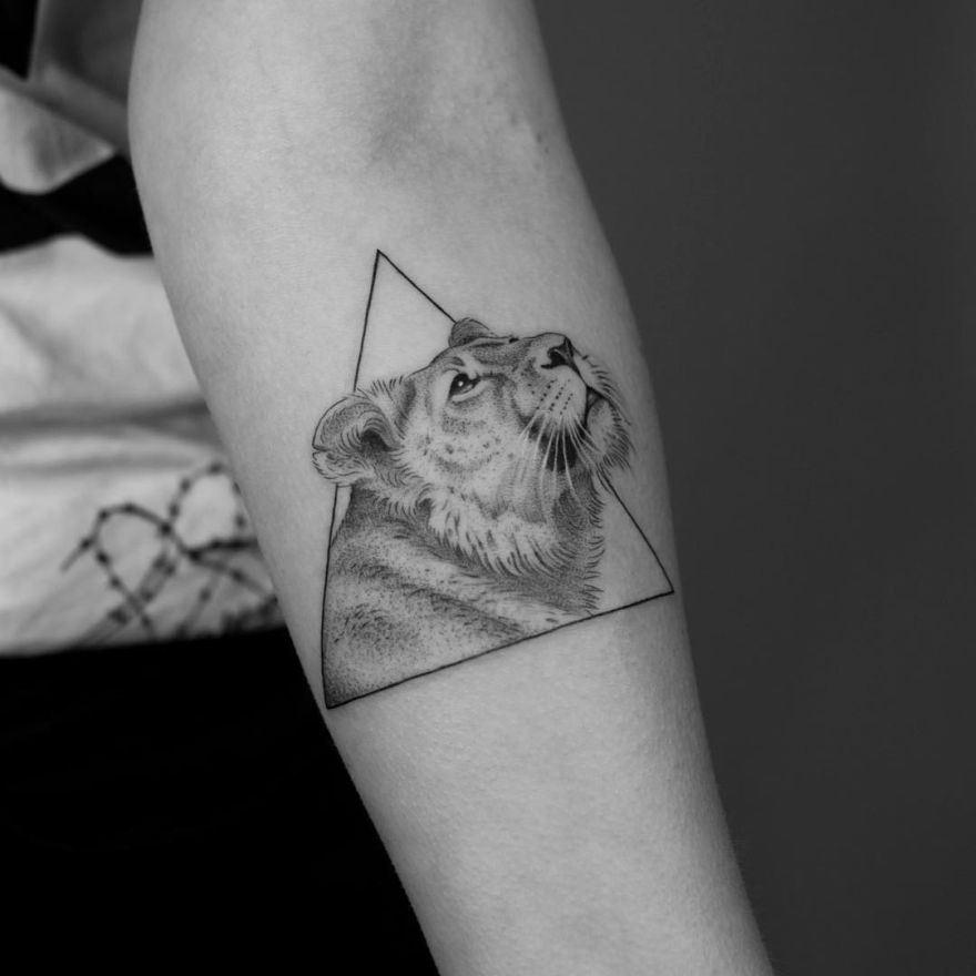 geometric lioness tattoo