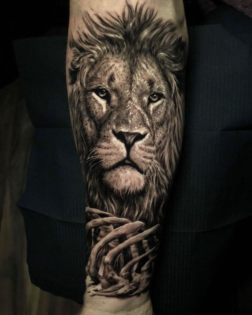 hyper-realistic lion tattoo