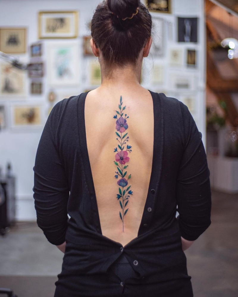 floral spine tattoo