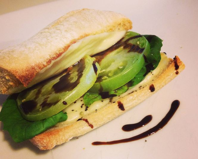 Happy green tomato and mozzarella panini