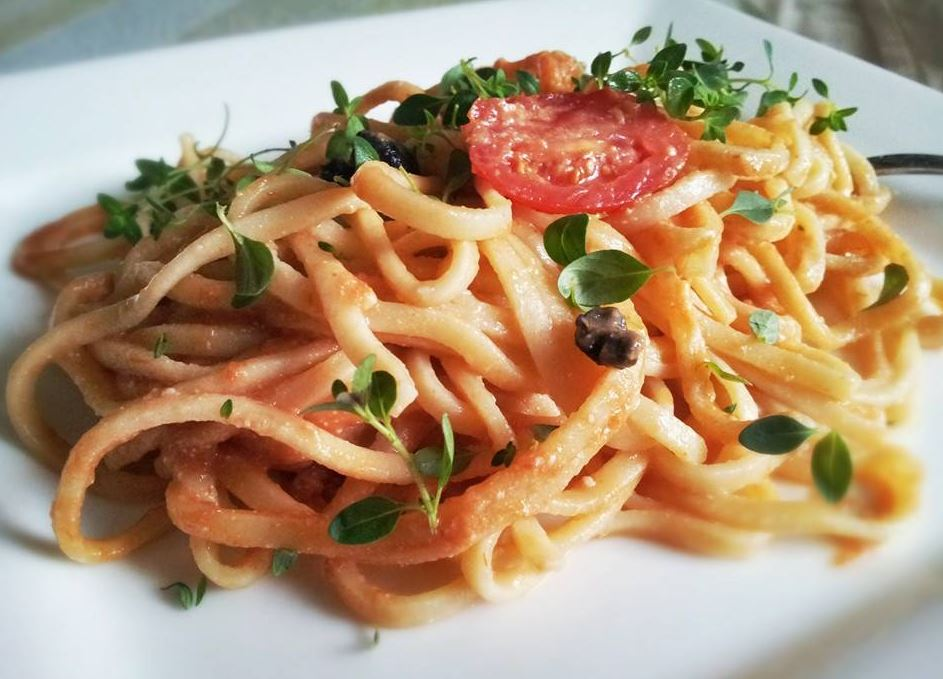 Fresh, homemade linguine with tomato and black olives