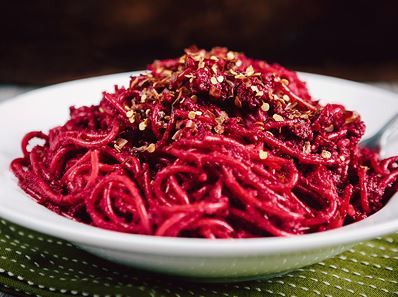 Beetroot spaghetti with walnuts and sun dried tomatoes