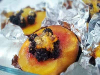 Berry filled baked peaches
