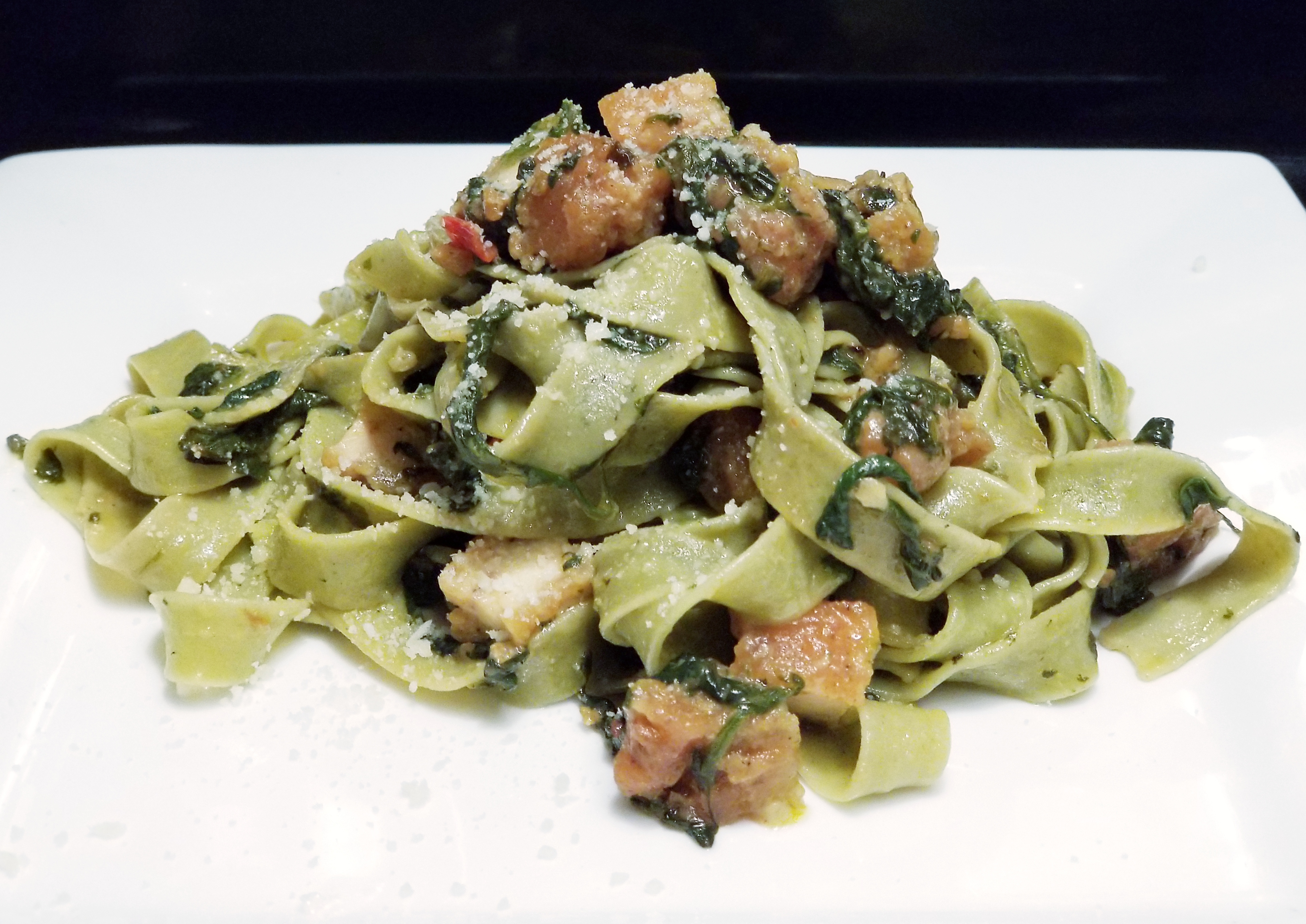 Organic kale and spinach fettuccine with chicken Parmesan