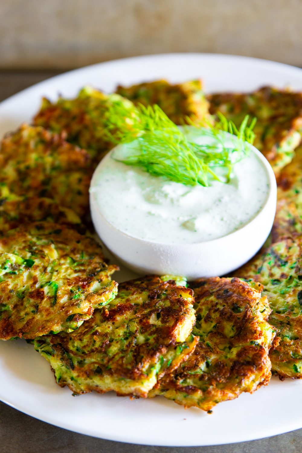 Zucchini fritters with dill and yogurt sauce