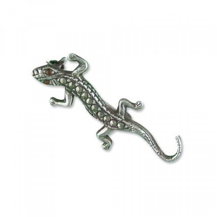 Mercasite lizard with garnet eyes