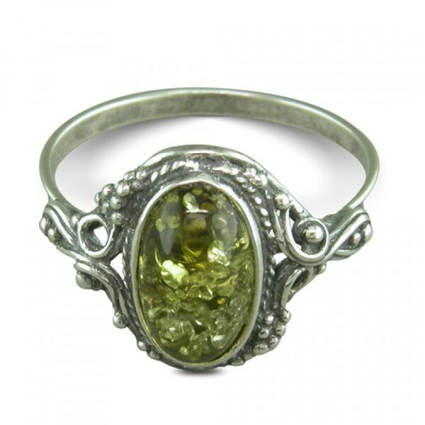 Oval green amber fancy surround