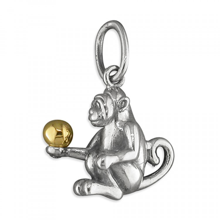 Sitting monkey with gold ball