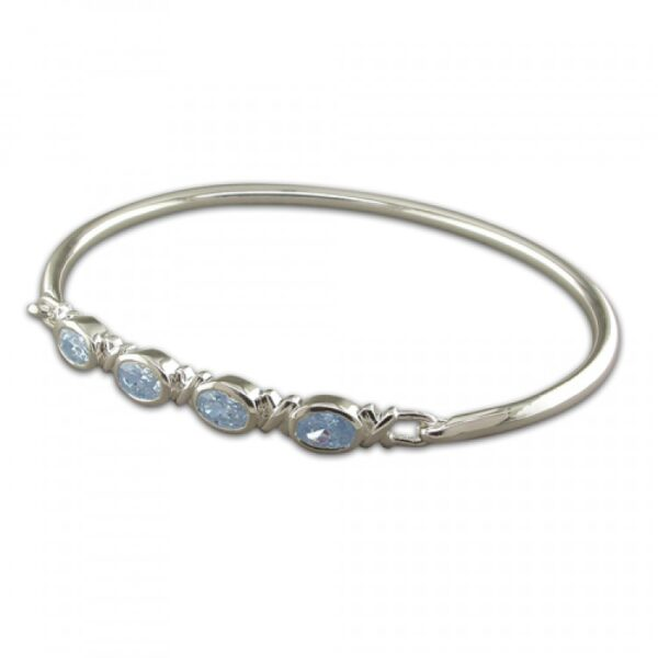 4 in line oval blue topaz