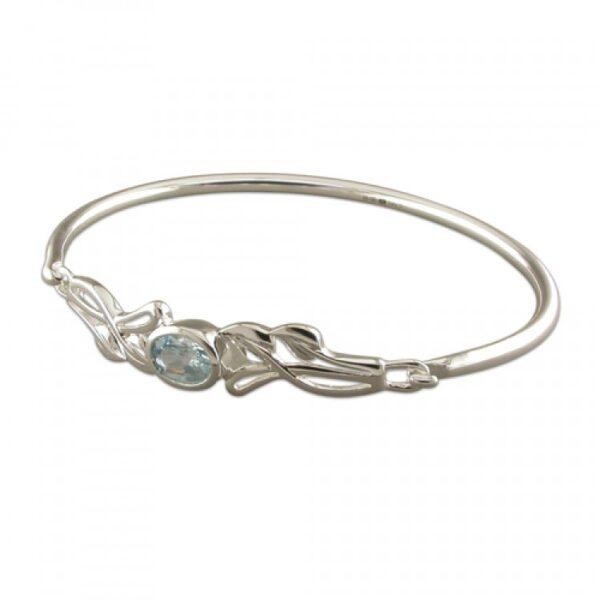 Oval blue topaz in fancy loops