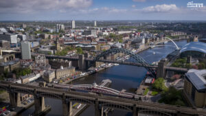 drone photography filming inspections hire services Newcastle Gateshead quayside taken by drone. Aerial photography of the Tyne Bridge, High level bridge, swing bridge. Licensed drone operations