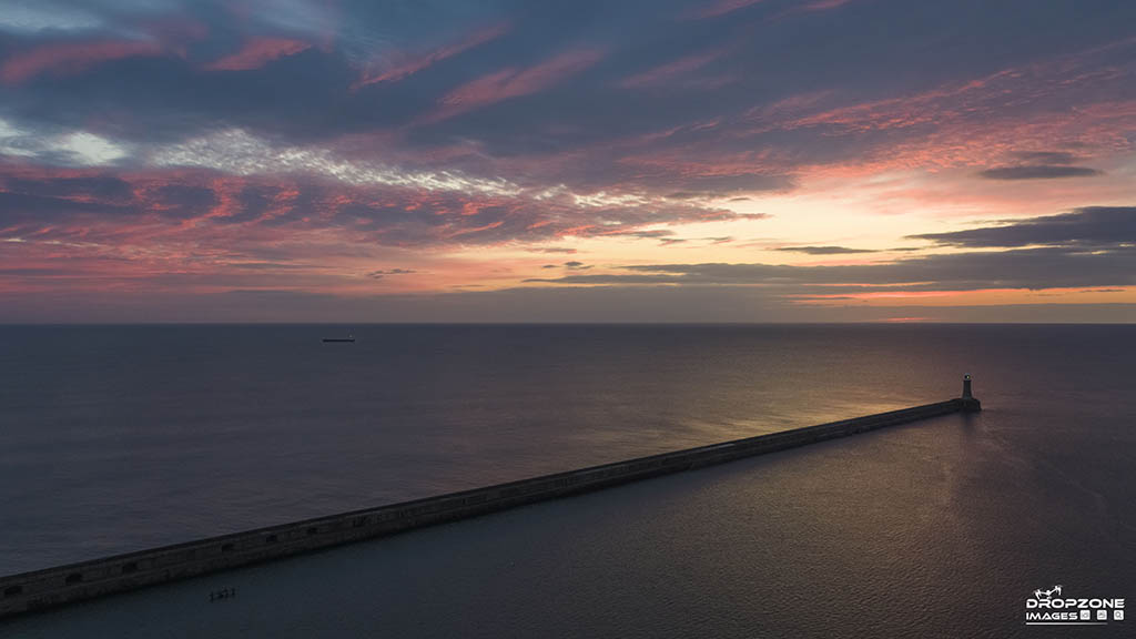 Tynemouth pier by drone. Sunrise over the tyne registered licensed and insured drone operator
