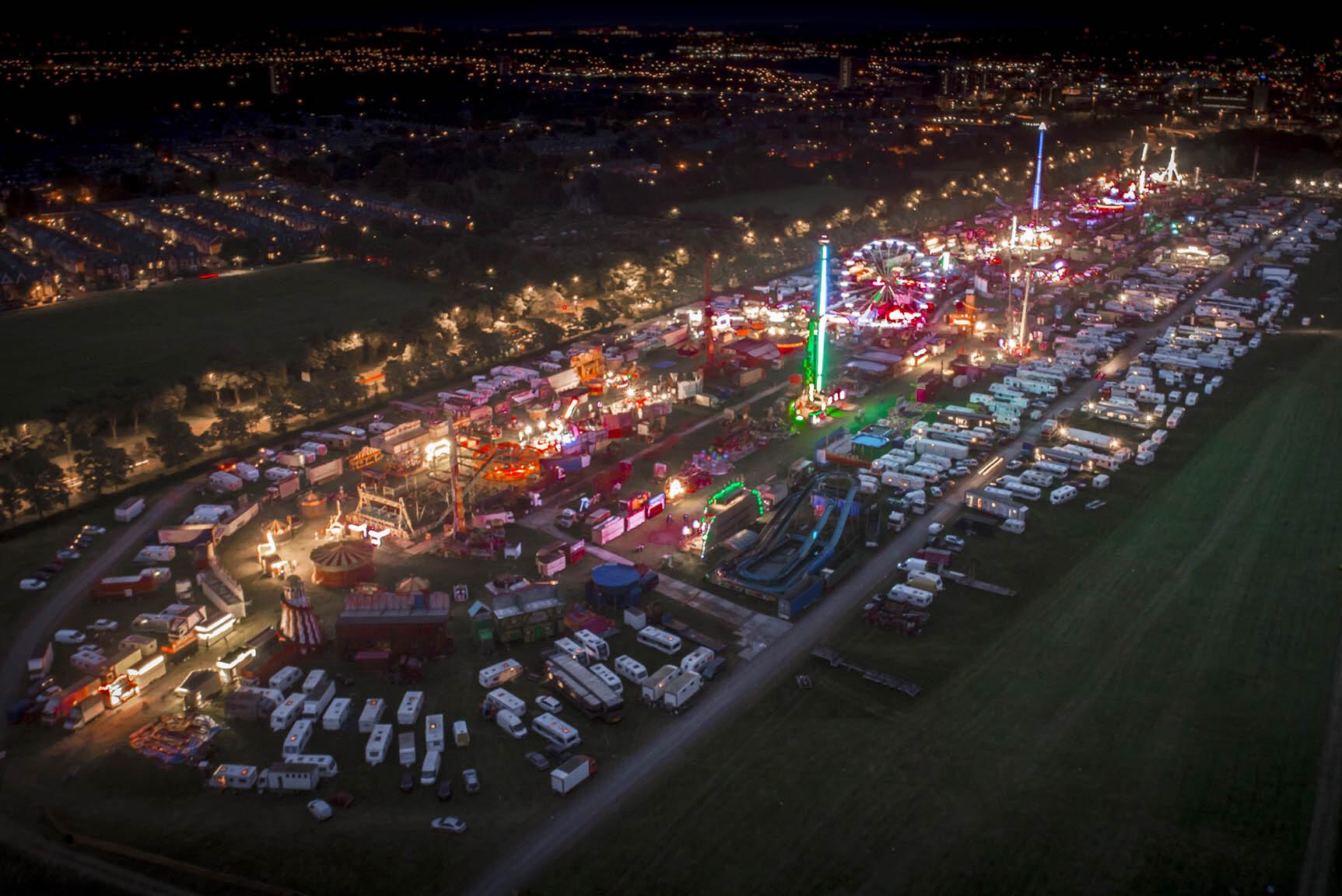 Largest travelling fair seen by drone. Night aerial photography