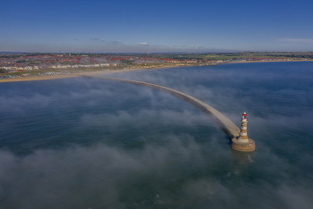 Above the clouds in Roker. DJI drone with qualified drone operator in Sunderland