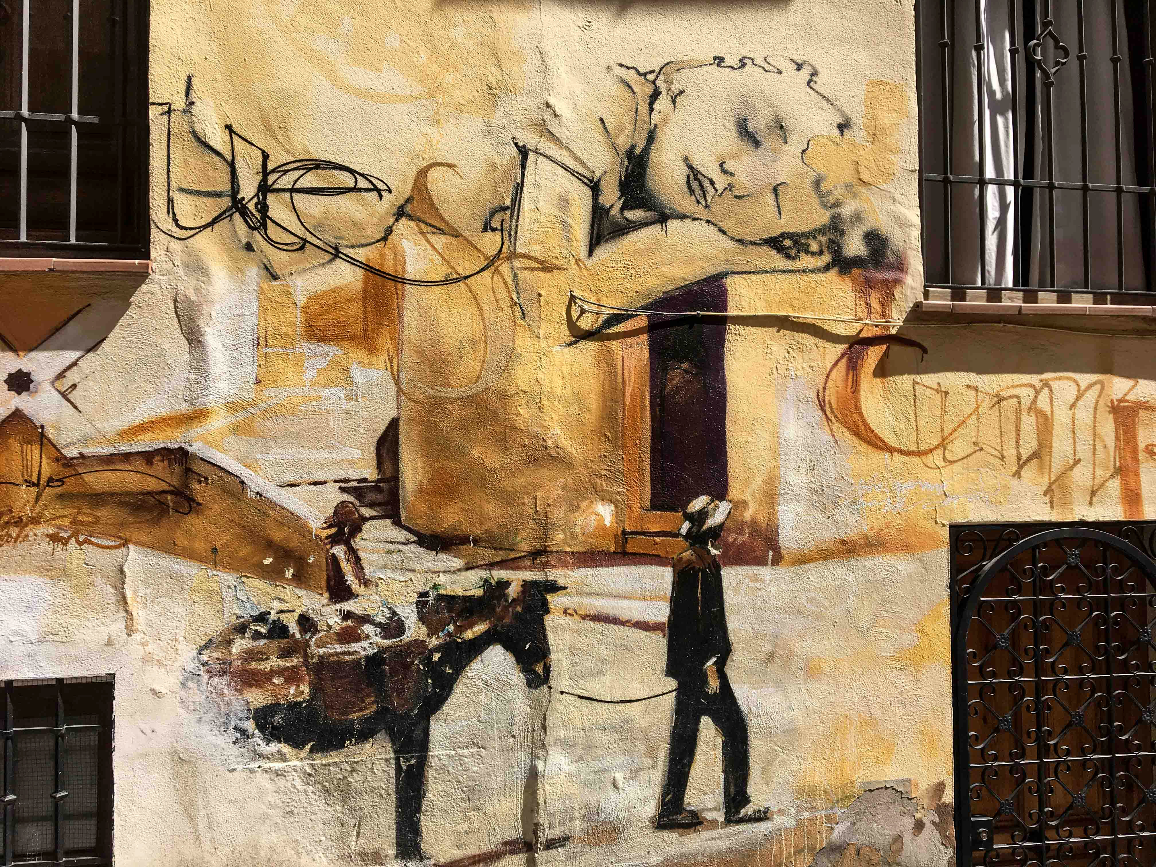 Ausschnitt aus einem Mural von El Niño de las Pinturas dass ein schlafendes Kind und einen Mann mit einem Esel zeigt