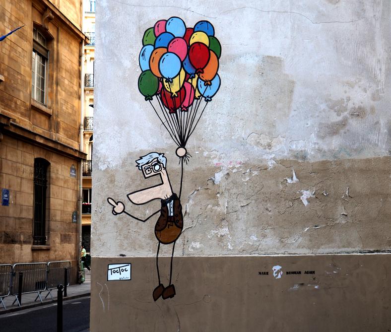 Mann mit Luftballons