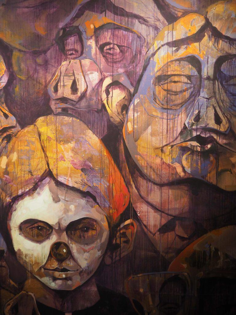 diverse Gesichter z.T. mit Maske