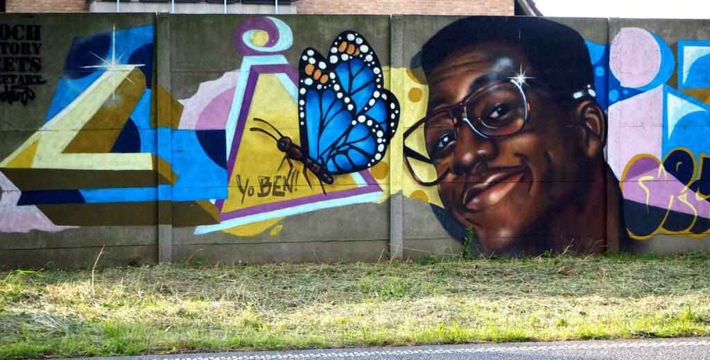 Mann mit Schmetterling
