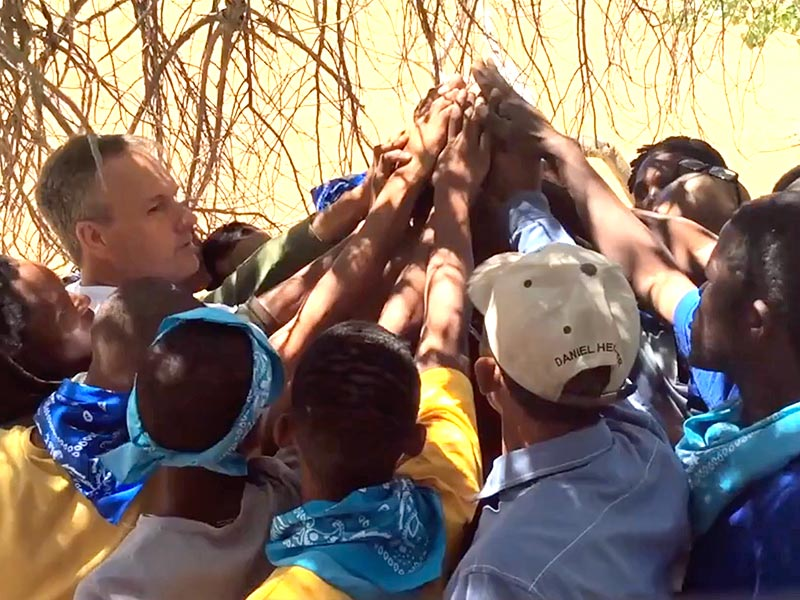 Father A Nation De Aar - men joining hands in a pledge.