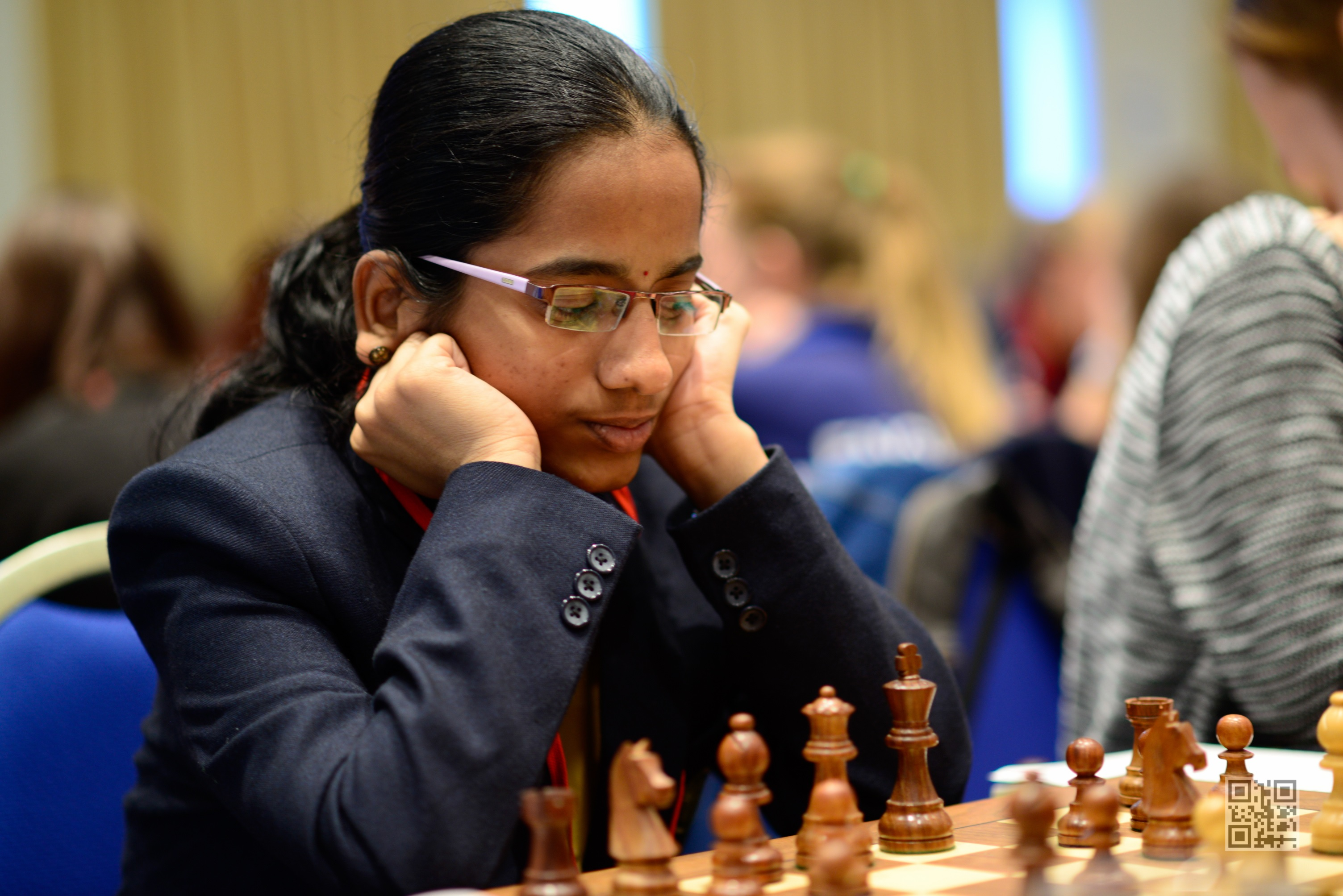 M. Mahalakshmi is in lead in the girls' U18 section with 6.5 points.