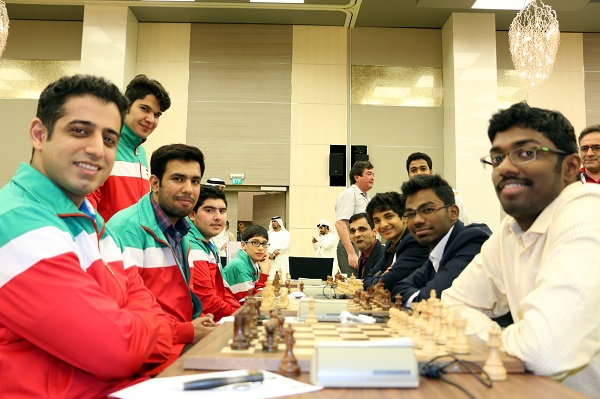 GM B. Adhiban (right foreground) beat GM Ehsan Ghaem Maghami to lead India to a devastating 3.5: -0.5 win over Iran