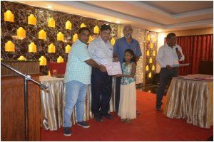Children receiving Merit Certificates from President G.Bhaskar, Sh Lanka Ravi and ShPrasad,Vice President ANCA