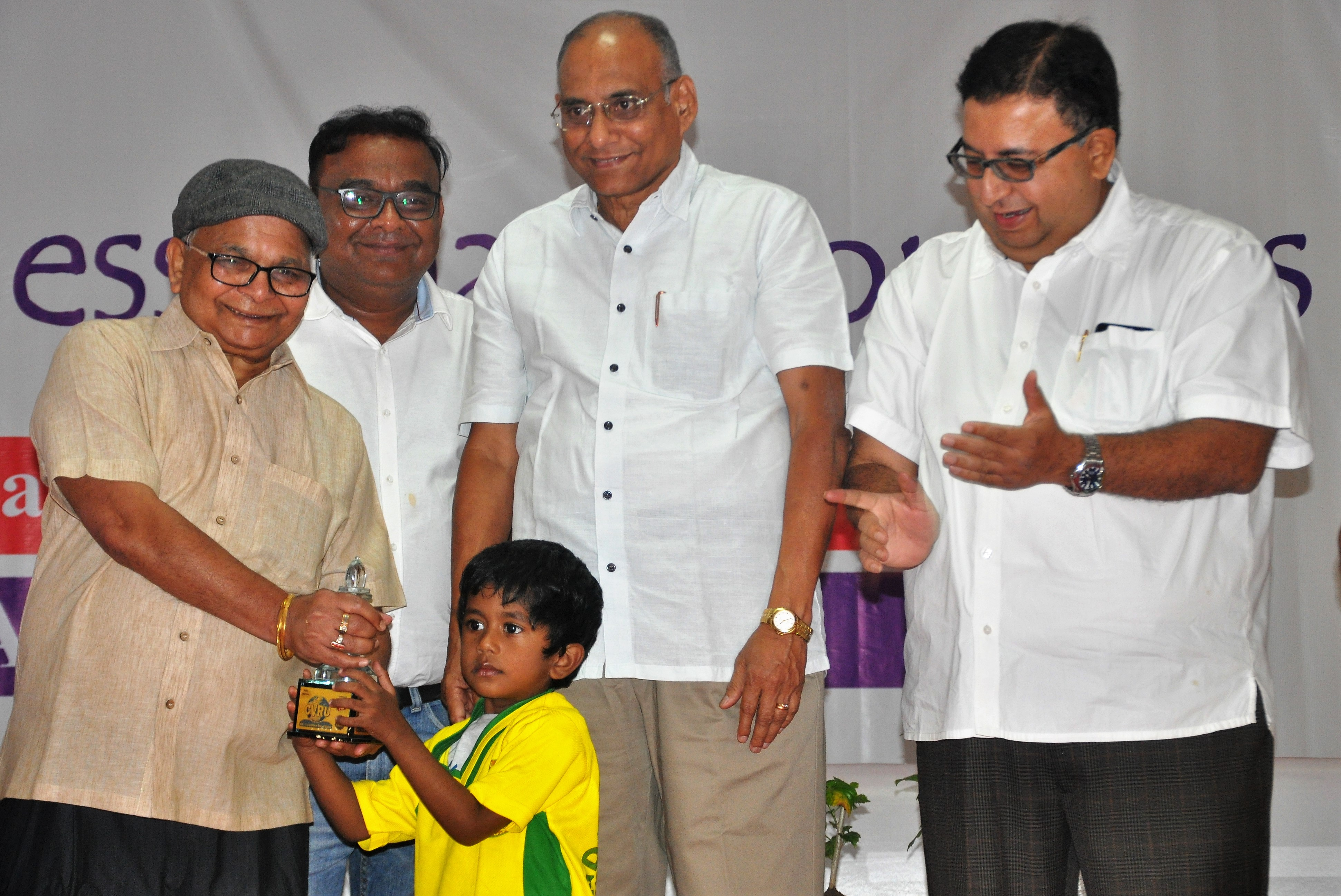 Youngest Player OPEN receiving trophy