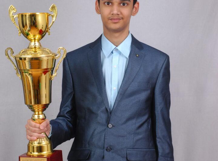 Raja Rithvik holding U-17 national Trophy