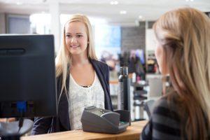 Receptionist Helping Customer at Beauty Salon