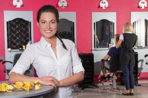 young attractive female receptionist of beauty salon
