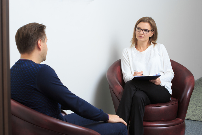 Therapy session between client and therapist