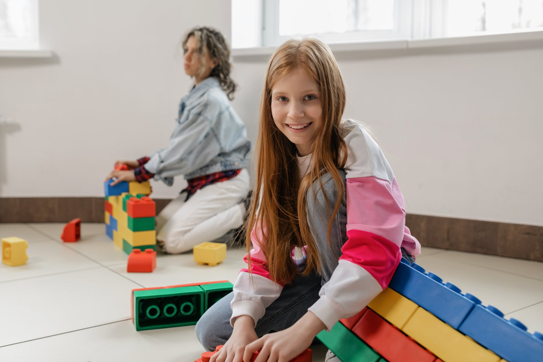 children playing with giant lego blocks