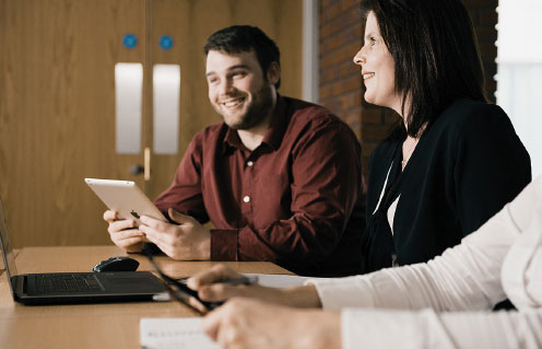 Two Arden Software staff members sat at a table