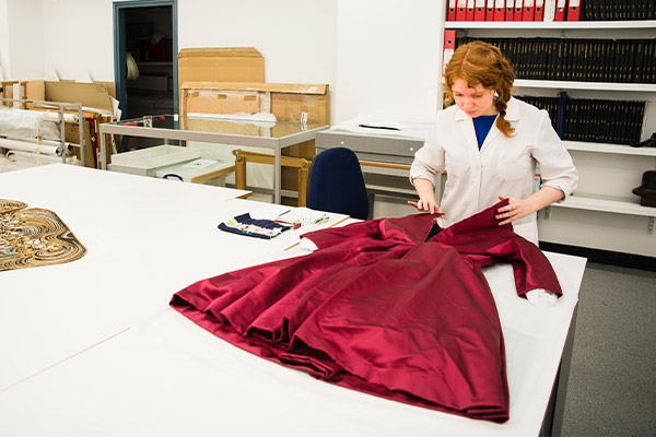 Centre for Textile Conservation - PhD student MPhil student treating a silk satin dress by Christian Dior (1950s)