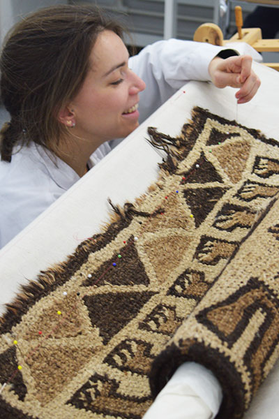 Centre for Textile Conservation - MPhil Textile Conservation student conserving an Ethopian rug