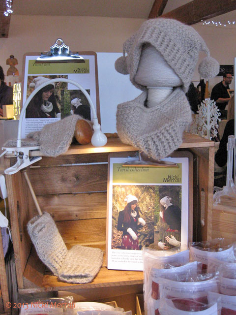 Display of hat and cowl on cones of yarn