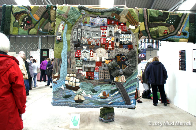 Giant knitted cardigan showing scenes from the town of Cardigan