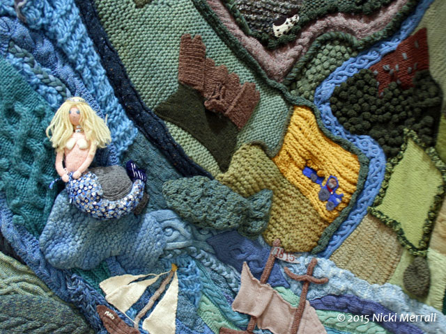 Detail of the scenes from the town of Cardigan on a giant knitted cardigan