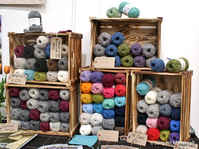 Balls of woollen yarn arranged in wooden crates