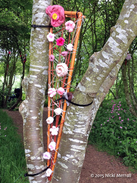 Knitted cherry blossom in a tree