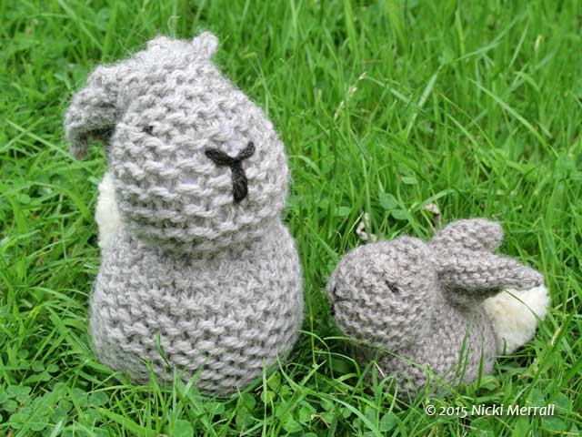 Big and little knitted bunnies made from a square of garter stitch
