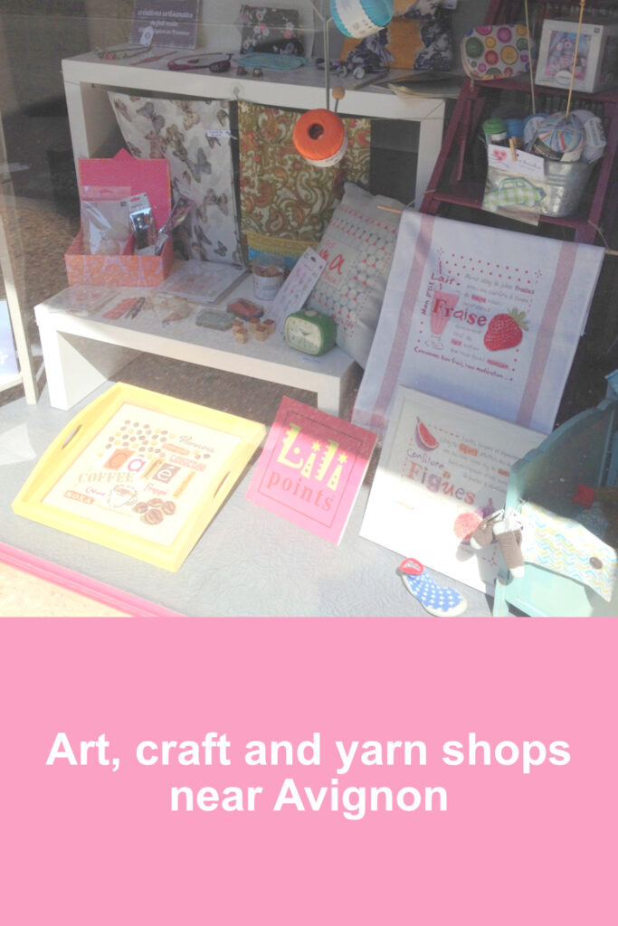 Window display of cross stitch kits in Kalate, Avignon