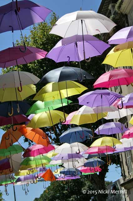 Umbrellas in the street, Arles