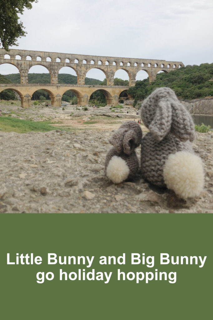 Little Bunny and Big Bunny looking up at the Pont du Gard in the distance