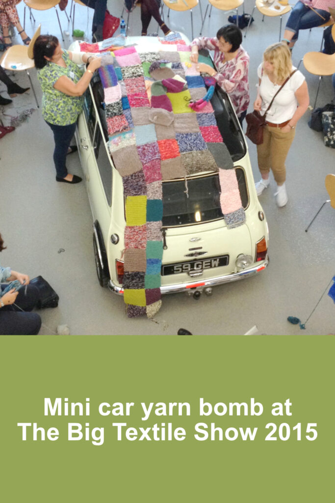 Knitters stitching squares together to cover a Mini car