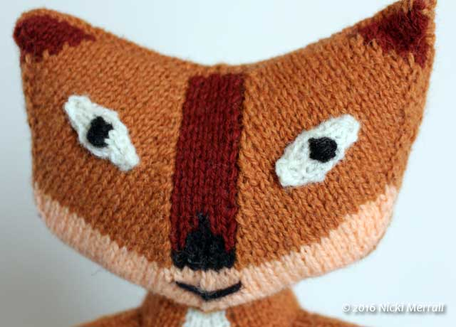 Close-up of face of knitted fox