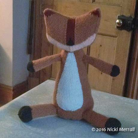 Knitted fox body before adding eyes